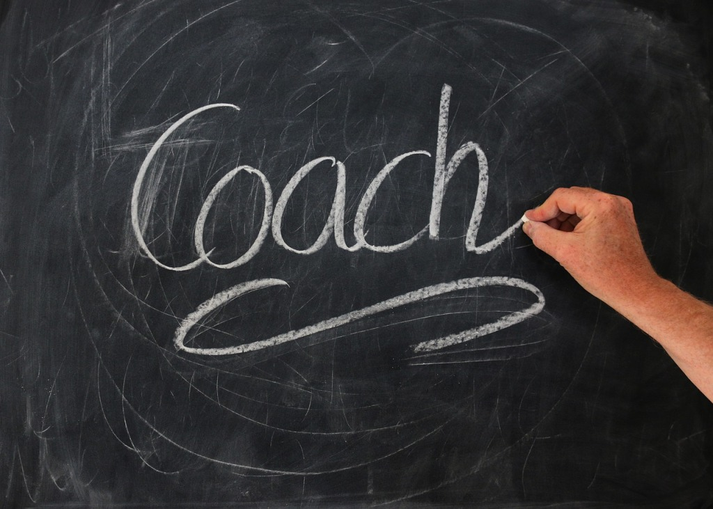 Coach on blackboard