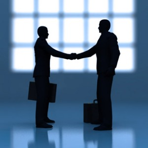 Business and Academia shake hands