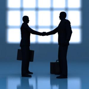 Business and Academia shake hands
